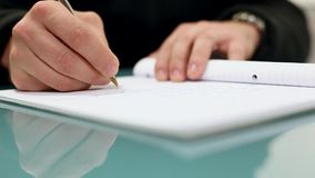 Caucasian male writing in notebook stock footage