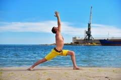 Caucasian man acts yoga Stock Images