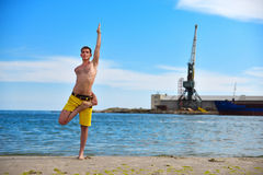 Caucasian man acts yoga Royalty Free Stock Images