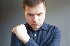 Caucasian man with angry mood. Young man looking seriously forward, carefully looking royalty free stock photography