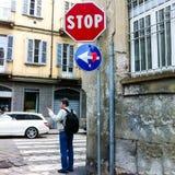 Caucasian man points the destination stock images