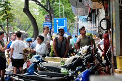 Caucasian man in backpacking travel. HO CHI MINH CITY, VIET NAM- DEC 2, 2017: Group of caucasian man in vacation by backpacking travel on Saigon street, male royalty free stock image