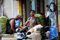 Caucasian man in backpacking travel. HO CHI MINH CITY, VIET NAM- DEC 2, 2017: Group of caucasian man in vacation by backpacking travel on Saigon street, male stock photo