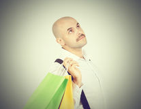 Caucasian man bald,  with colorful shopping paper bags Royalty Free Stock Photo