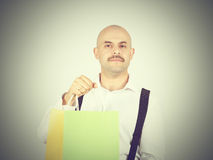 Caucasian man bald,  with colorful shopping paper bags Stock Photos
