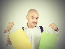 Caucasian man bald,  with colorful shopping paper bags Royalty Free Stock Image