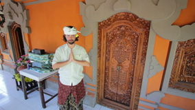 caucasian man in balinese clothes saluting asian style both hands stock video