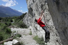 Caucasian man is bouldering Royalty Free Stock Images