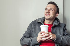 Caucasian man in cafe with paper cup of Coffee Stock Photo