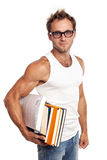 Caucasian man carrying stack of books Royalty Free Stock Image
