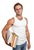 Caucasian man carrying stack of books Stock Photo