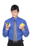 Caucasian man comparing lime to lemon Royalty Free Stock Photo