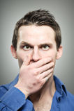 Caucasian Man Covering Mouth With Hands Portrait Royalty Free Stock Photos