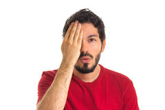 Caucasian man covers an eye with his hand. eyesight test chart. Stock Images
