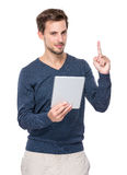Caucasian man with digital tablet and finger point up Stock Photography