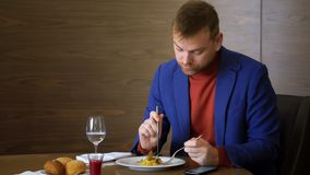 Caucasian man drink water from glass and using mobile phone on business lunch. Caucasian man drinking water from glass and using mobile phone during business stock footage