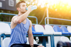 Caucasian man drinking water with his eyes closed after exercises Stock Photo