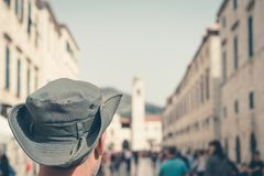 Caucasian man in Dubrovnik. Head of a caucasian male tourist wearing a hat walking through the Old Town in Dubrovnik, Croatia stock photography