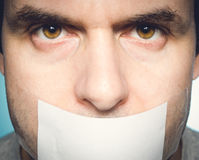 Caucasian man with duct tape on mouth, white . Stock Photography