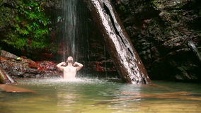 caucasian man enjoying in waterfall under water stock video footage