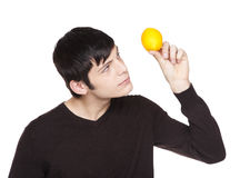 Caucasian man examining a lemon Royalty Free Stock Images