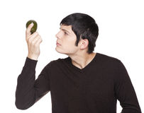 Caucasian man examining a lime Royalty Free Stock Photos
