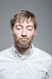 Caucasian Man Eyes Closed Smirking Portrait Stock Photography