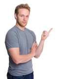 Caucasian man with finger pointing up Stock Images