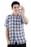 Caucasian man gesturing OK sign. Portrait of young person gesturing OK sign, isolated on white background Stock Photography