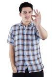 Caucasian man gesturing OK sign Stock Photography