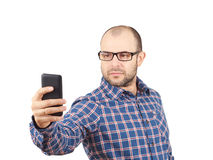 Caucasian man with glasses making a selfie. Stock Images