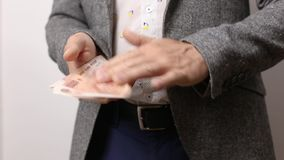 Closeup on male hands throwing money gesture. wealth, richness and wasting dough