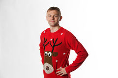 Caucasian man with hand on hips whilst wearing a christmas jumper looking to camera Royalty Free Stock Photos