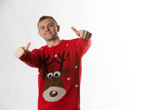 Caucasian man with hand on hips whilst wearing a christmas jumper looking to camera Stock Image