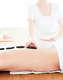 Caucasian man having a massage with hot stones Stock Photos