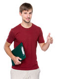 Caucasian man hold clipboard and thumb up Stock Image