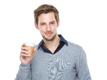 Caucasian man hold with coffee cup Royalty Free Stock Images