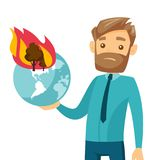 Caucasian man holding globe with forest in fire. Young caucasian white man holding globe with forest in fire. Concept of environmental destruction, wildfire Stock Photo
