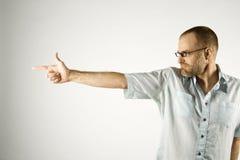 Caucasian man holding hand like gun. Royalty Free Stock Photos