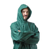 Caucasian man in hooded rain suit isolated on white background. Royalty Free Stock Photos