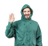 Caucasian man in hooded rain suit waiving with palm isolated on Stock Photography