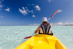 Caucasian man kayaking in sea at Maldives Royalty Free Stock Image