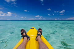 Caucasian man kayaking in sea at Maldives Royalty Free Stock Photos
