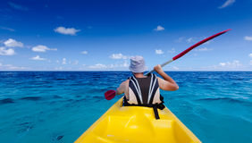 Caucasian man kayaking in sea at Maldives Stock Photography