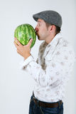 Caucasian man kiss a water-melon Stock Photos