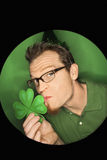 Caucasian man kissing shamrock. stock images
