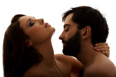 Caucasian man kissing woman's neck. Royalty Free Stock Photography