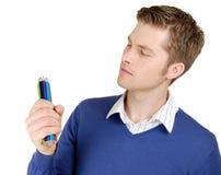 Caucasian man looking at color pencils Royalty Free Stock Image