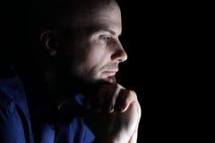 Sad looking man. Caucasian man looking depressed close up on black background Stock Images