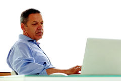 Caucasian man looking at his laptop computer Royalty Free Stock Images